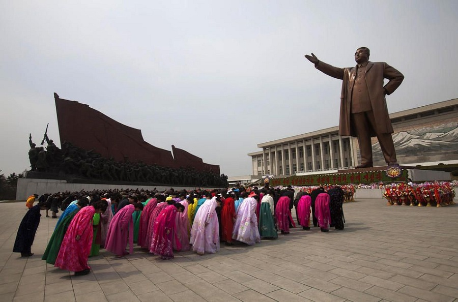"North Koreans pay their respects before a monument of Kim Il Sung at Mansu Hill in Pyongyang, North Korea, Thursday April 14, 2011. People began to celebrate on the eve of 99th anniversary of Kim Il Sung's birthday. April 15 is called ""The Day of the Sun"" in honor of the former guerrilla fighter who founded North Korea in 1948. (AP Photo/David Guttenfelder)"